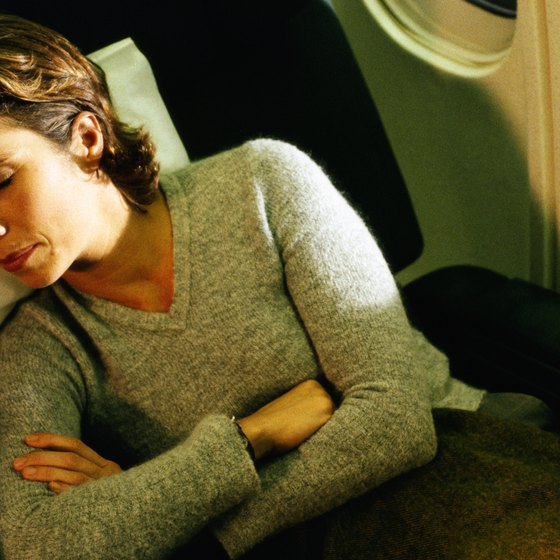 Sleeping through the flight is the best way to eliminate discomfort.