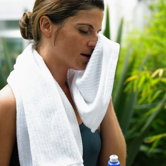 Wiping sweat off with a towel won't allow the sweat to evaporate.