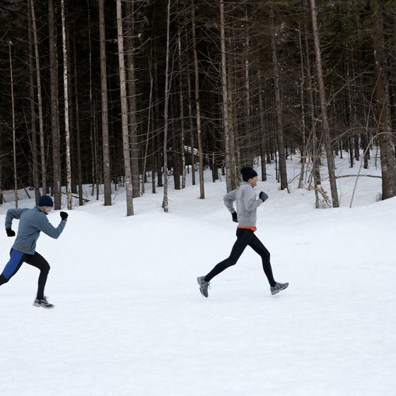 Dress warmly and in layers to keep your body temperature up and prevent hypothermia while running.
