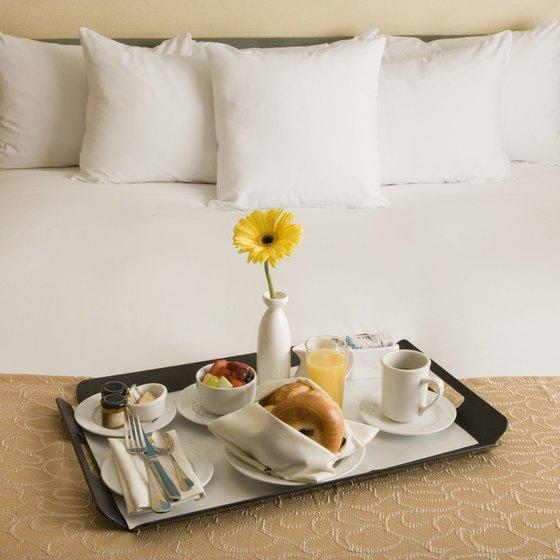 Breakfast on bed in hotel room.