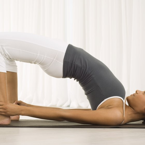 Bridge pose stretches the hip flexors.