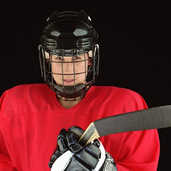 A hockey jersey should fit loosely over the shoulder pads and chest protector.