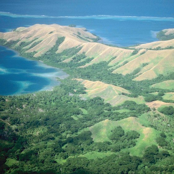Cruise past Vanua Levu Island in Fiji while in the South Pacific.