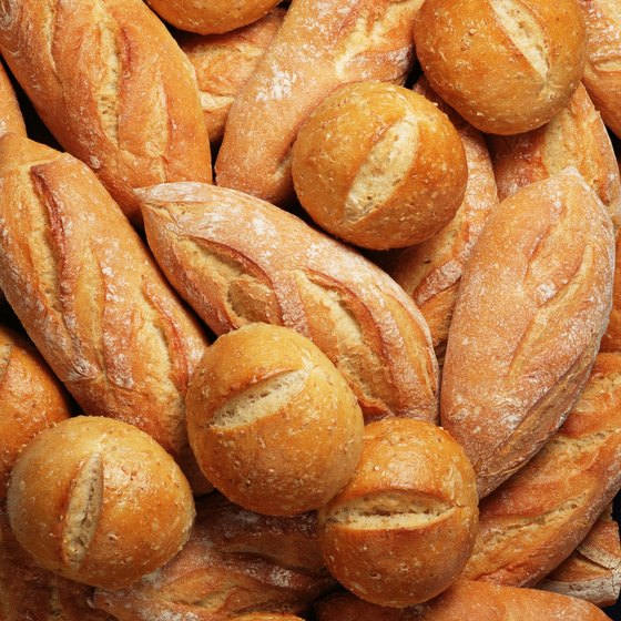 A gluten-free diet restricts your intake of traditional bread, which can help you save calories.