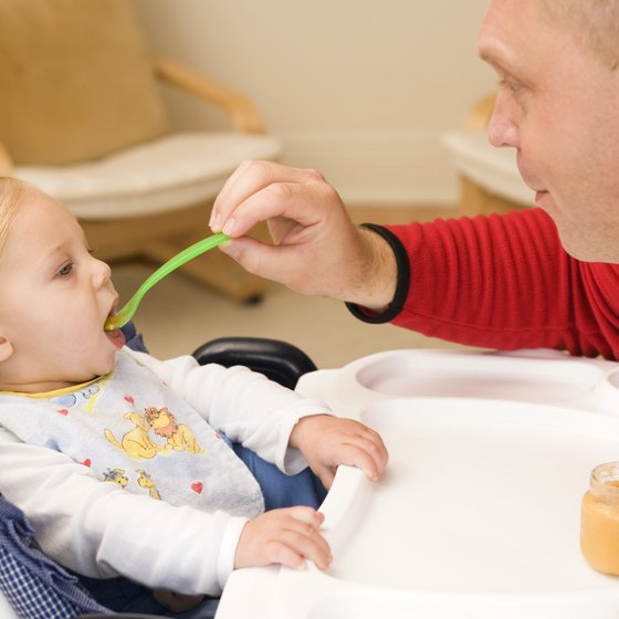 Other family members become part of baby's feeding routine at age 6 months.