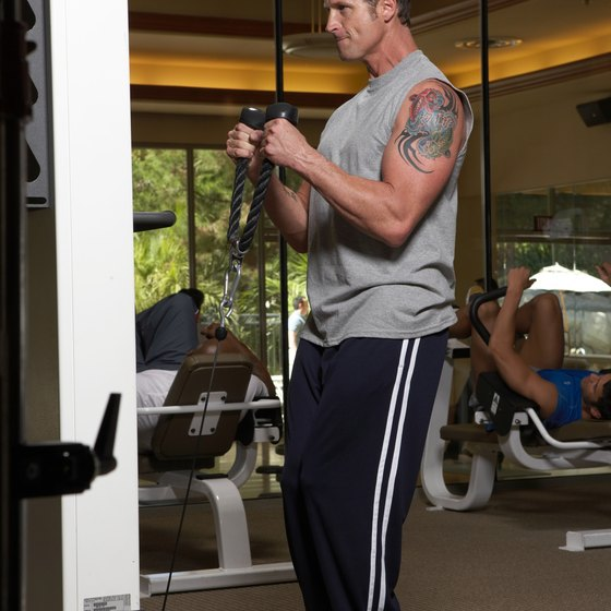 Combine machine and free weight exercises to effectivly work the medial triceps.