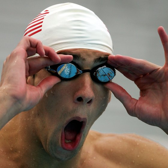 U.S. Olympic gold medal winner Michael Phelps adjusts his goggles before competing.