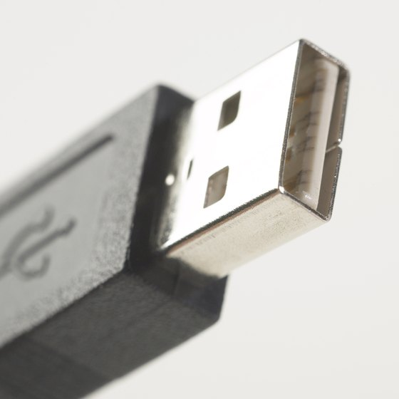 Multiple pairs of USB headphones will not work at the same time in different ports.
