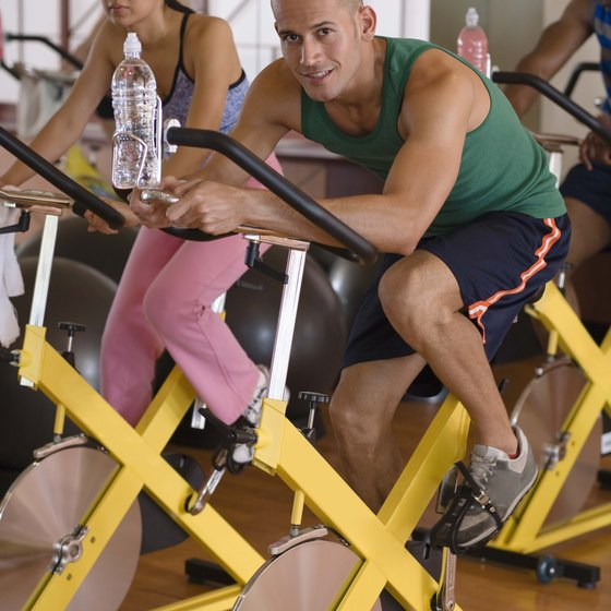 Bring a water bottle with you to stay hydrated while exercising on a stationary bike.