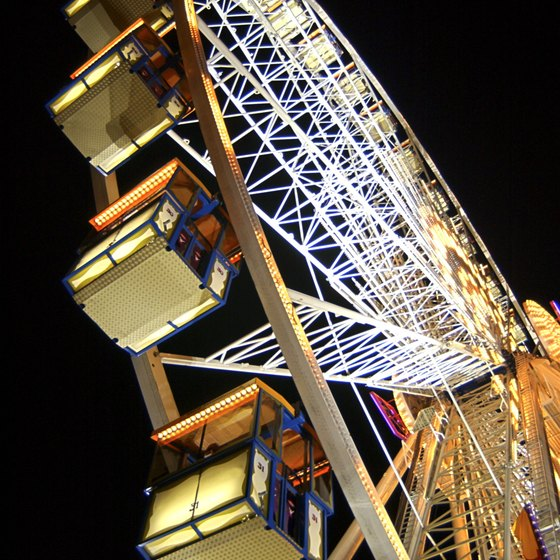 Rides such as the venerable Ferris wheel thrill Los Angeles County Fair visitors on Labor Day.