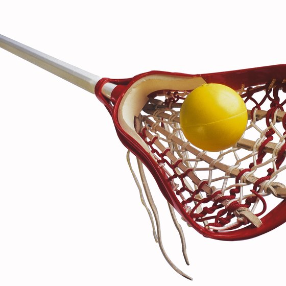 Lacrosse balls are designed to bounce; field hockey balls are not.