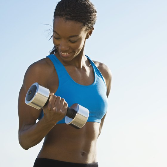 Dumbbell curls can add definition to your upper arms.