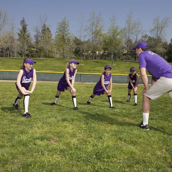 Stretches such as lunges help loosen the muscles of softball players.