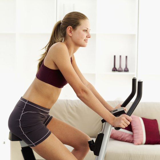 Riding an exercise bike engages several muscle groups.