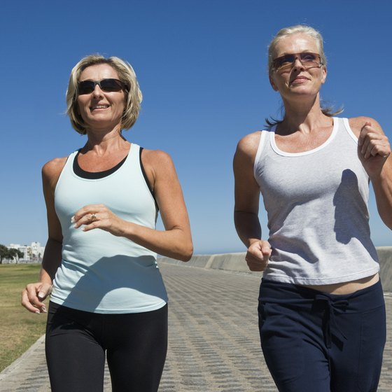 These two women are activating most of their muscle groups by running.