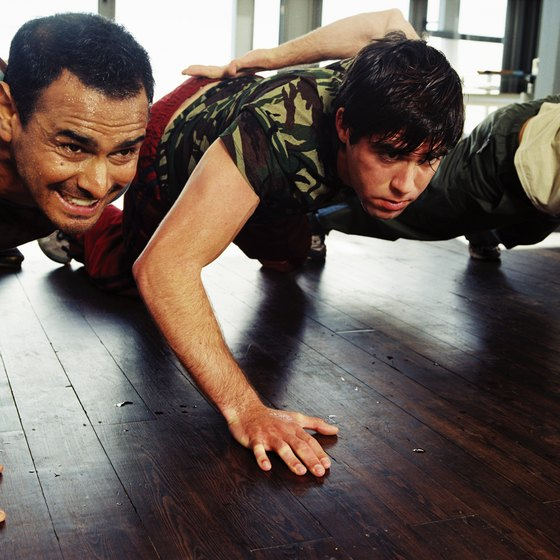 Combat conditioning uses bodyweight exercises such as pushups.