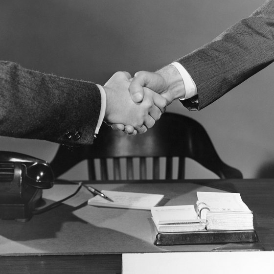 Mergers can start with a handshake, but signed documentation seals the deal.