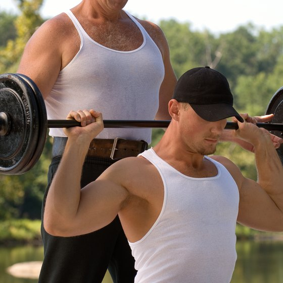 The behind-the-neck press works your lower traps and serratus anterior simultaneously.