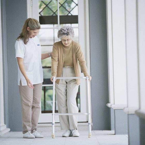 A nurse helps an elderly patient at a nursing home.