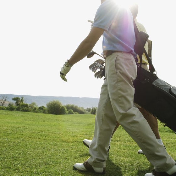 Carry your clubs for a superior golf workout.