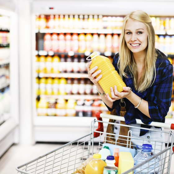 Woman holding juice at grocery store