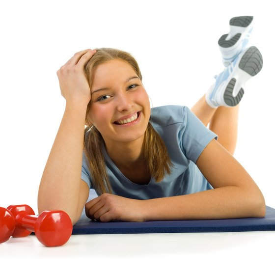 Exercise with weights at home to get fit.