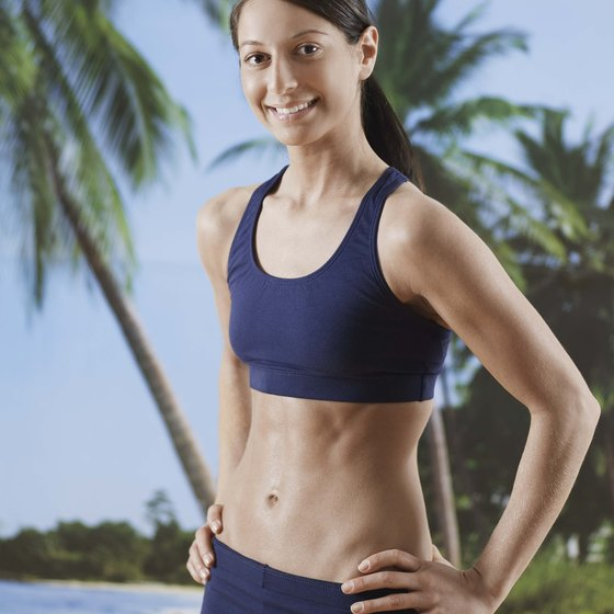 Flatten your stomach and shrink your midsection with circuit training and aerobics.