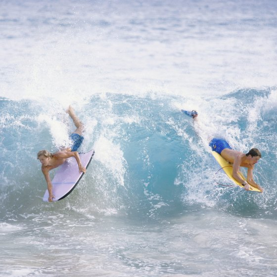 Advanced bodyboarders do tricks.