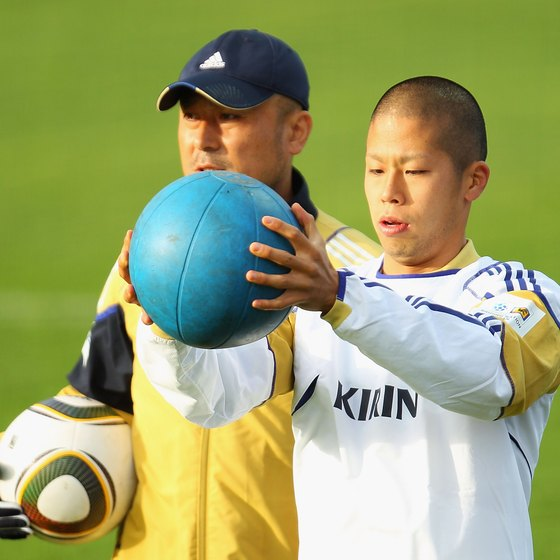 Japanese player Takayuki Morimoto works out with a medicine ball at a training session.