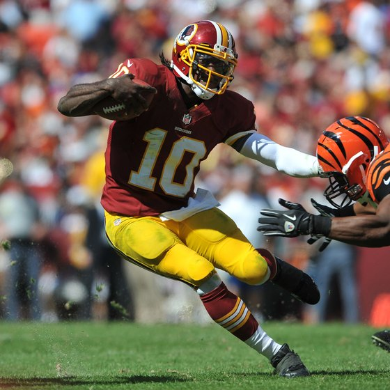 Washington quarterback Robert Griffin III runs the ball against the Bengals.