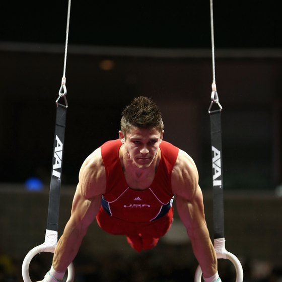 Protein and carbohydrates help give male gymnasts the strength and energy they need for workouts and meets.