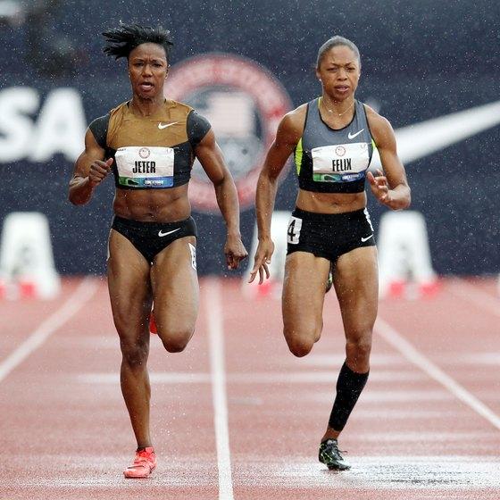 Carmelita Jeter, left, and Allyson Felix battle in the 100 meters.