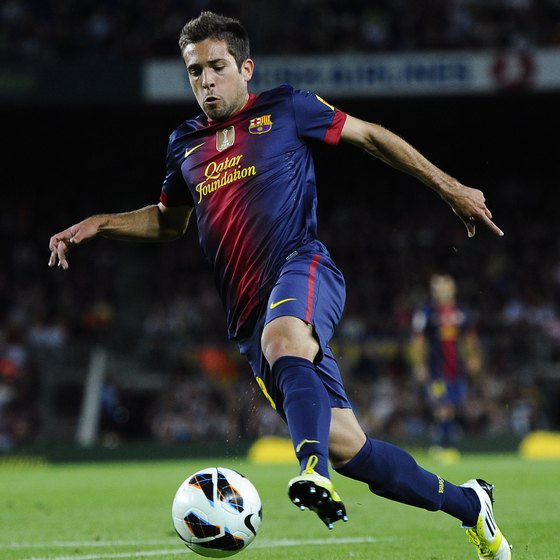 Left fullback Jordi Alba of Barcelona flies down the wing with the ball.