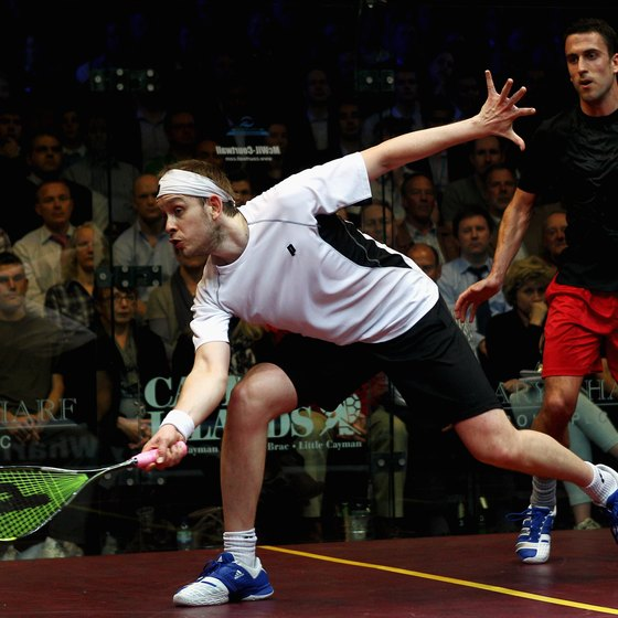 English player James Willstrop lunges for the ball.