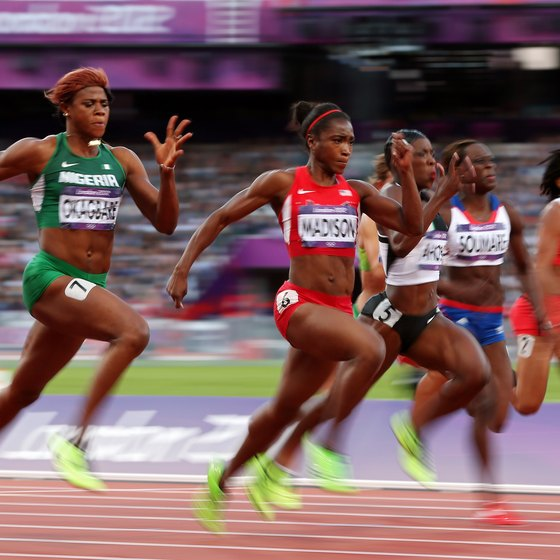 Olympic contenders in the women's 100 meters demonstrate the knee lift.
