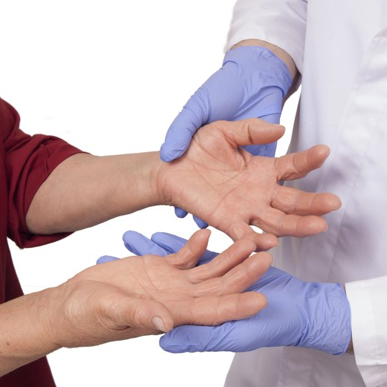 Doctor examining patient with arthritis.