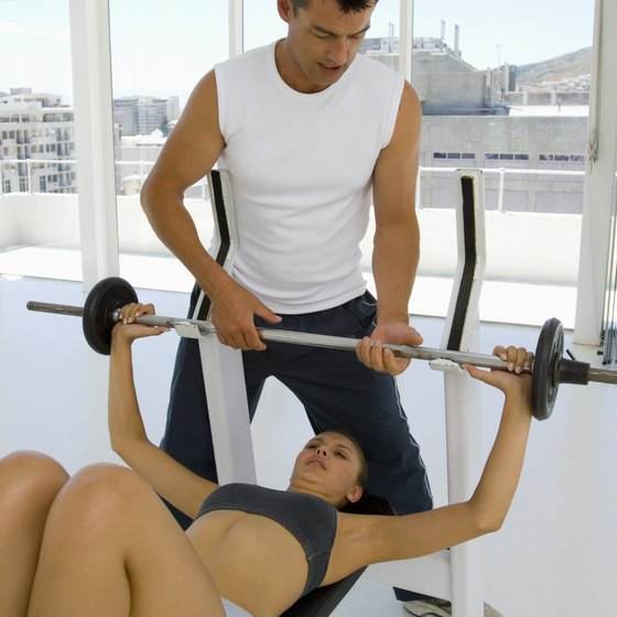 Always use a spotter when lifting heavy barbells during a chest press at any inclination.