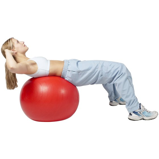 Doing a sit-up on a stability ball can help keep this ordinary exercise interesting.