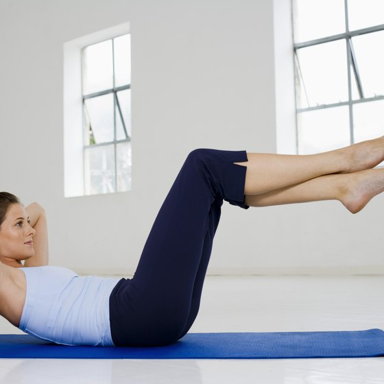 The bicycle maneuver combines crunches with leg and shoulder movement.
