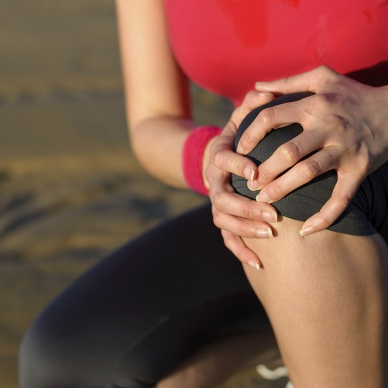 Athletic woman with knee pain