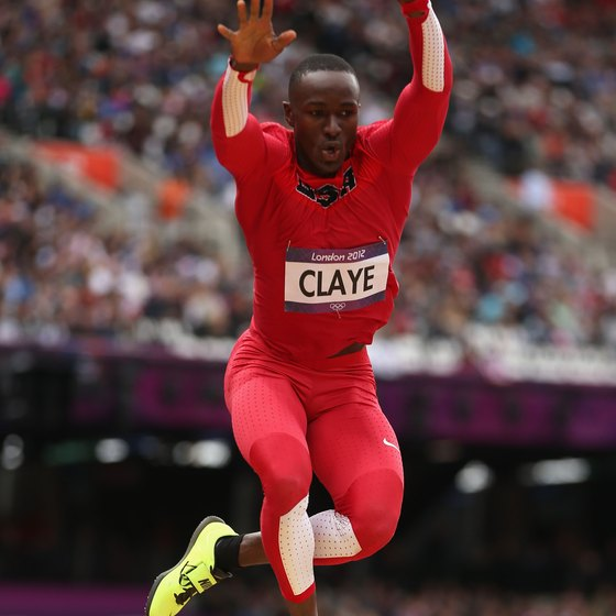 Olympic medalist Will Claye of Phoenix competes in the long jump.