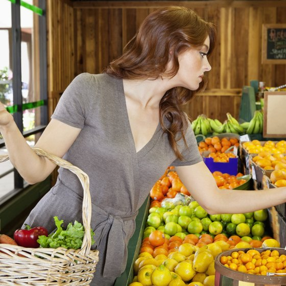 Woman shopping for fresh fruit and vegetables.