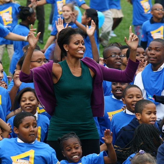 Michelle Obama leads school children in jumping jacks at the White House in 2011.