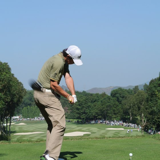 At the midpoint of his downswing, Rory McIlroy's firm wrists have maintained about a 90-degree angle between his left forearm and the club shaft.