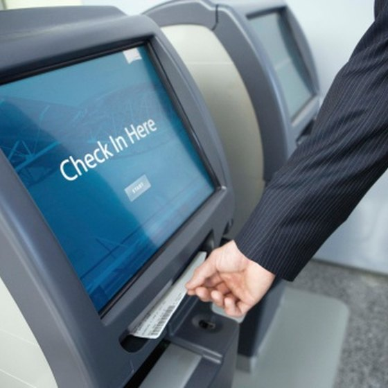 Book an electronic ticket and pick up your ticket at a kiosk in the airport.