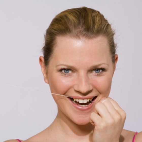 Flossing can remove hard to reach plaque that develops between teeth.