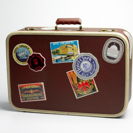 Vintage luggage from thrift stores is not only cheap and sturdy, it stands out among all the identical bags on the luggage carousel.