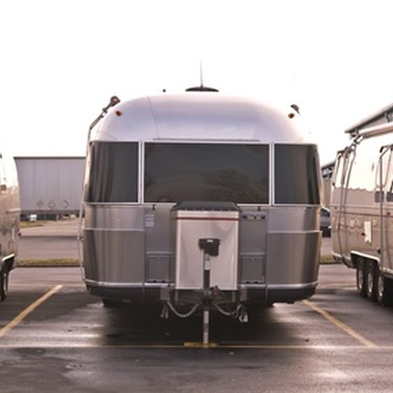 A travel trailer is non-motorized and pulled behind an automobile.