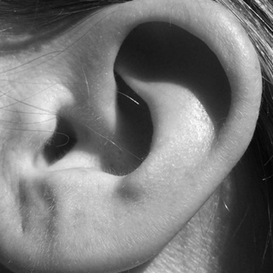Earwax buildup can reduce hearing ability.