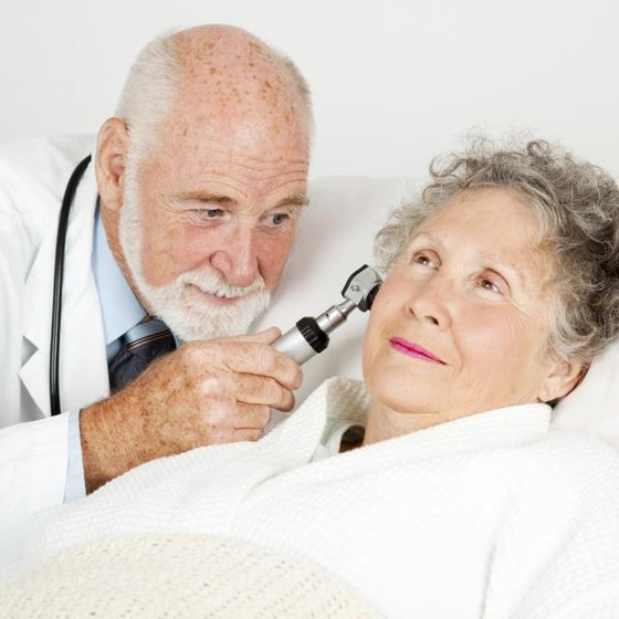 A doctor is examining a patient's ears.